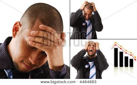 Frustrated Business Man With His Hands On His Head