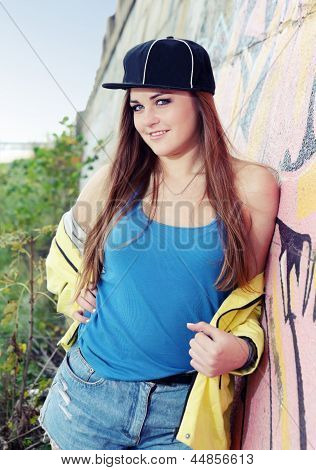 Teenager Girl Posing Near Wall