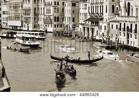 VENICE, ITALY - APRIL 11: A view of the Grand Canal from Rialto Bridge on April 14, 1013 in Venice, Italy. This main canal is 3800 meter long, 30-??90 meters wide, with an average depth of five meters