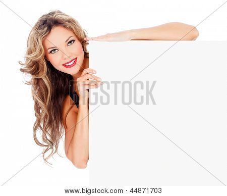 Excited young woman with a blank billboard