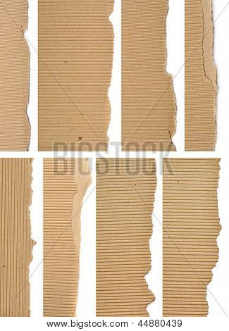 Set of textured cardboard with torn edges isolated over white poster