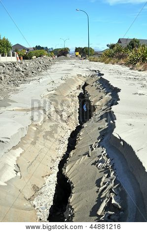 Earthquake Liquefaction Sand & Mud Explodes Through Cracks In Road