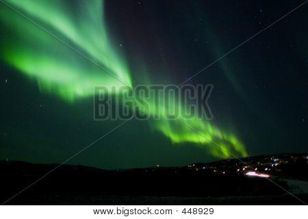Aurora Borealis Arc Over Hill Terrain