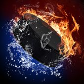 Hockey puck in fire flames and splashing water poster