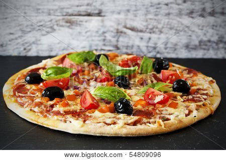 Pizza - Italian pizza with salami and black olives poster