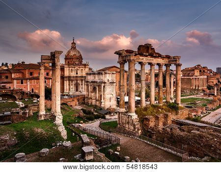 Roman Forum (Foro Romano) and Ruins of Septimius Severus Arch and Saturn Temple at Sunset Rome Italy poster