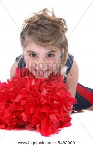 Close Up Of Pretty Cheerleader Girl's Face And Red Pompom