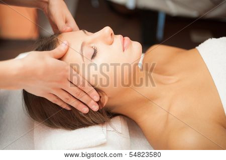 Beautiful woman having a facial massage