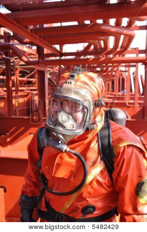 Man In Protectiv  Suit On Ship Deck