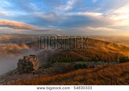 Sunset Over Hills In Clouds