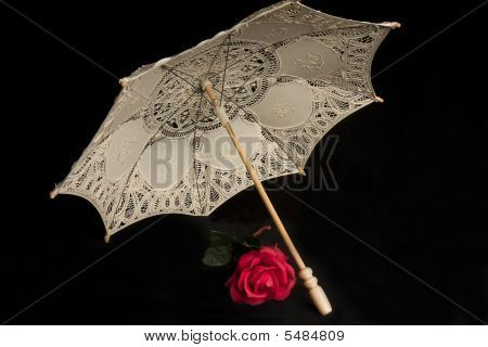 Parasol And Red Rose