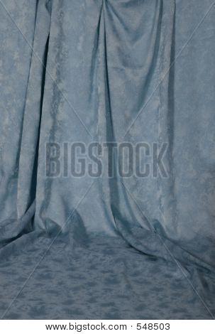 Light Blue Draped Backdrop