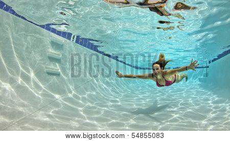 Woman In A Red Bikini Swimming Underwater