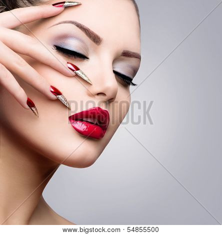 Fashion Beauty Model Girl. Manicure and Make-up. Nail art. Beautiful Woman With Red and Golden Nails and Luxury Makeup. Beautiful Girl Face and Hand