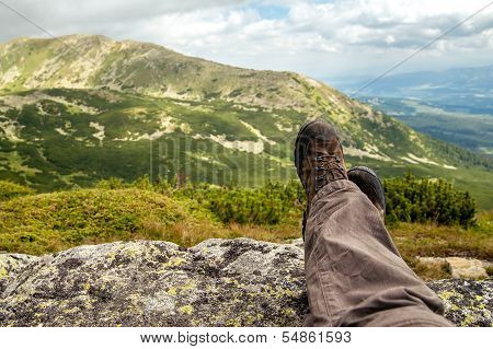 Hiking boots of a hiker while taking a rest