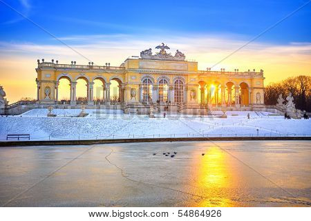 VIENNA - DECEMBER 13 2012: Gloriette in Schonbrunn Palace, Vienna, Austria illuminated by sunset on December 13, 2012. Built in 1775, it was used as a festival hall for emperor Franz Joseph I.