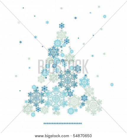 stylized silhouette of Christmas tree formed by snowflakes