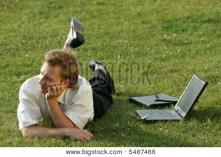 Relaxing Businessman On The Grass