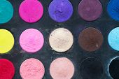 Makeup colorful eye shadow palettes as background poster