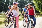 Family With Teenage Children On Cycle Ride In Countryside poster
