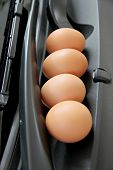 The Picture Eggs are placed in front of car. poster