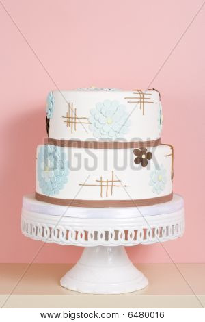 Whimsical Cake Against Pink Background