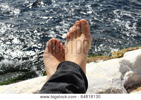 feet facing the sea