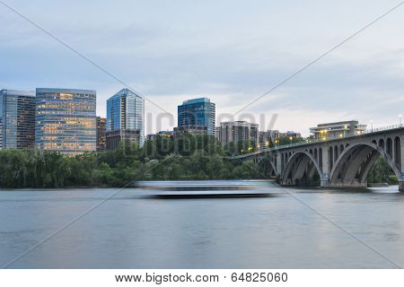 Washington DC - Key Bridge, Rosslyn and tourist boat in Potomac River in the eveniing