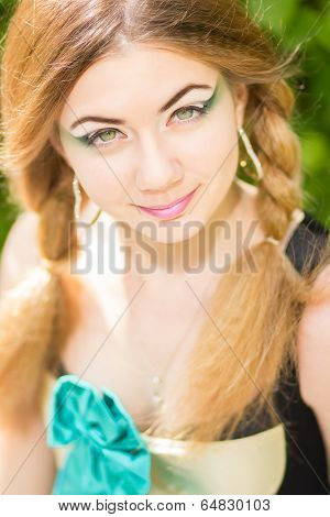 Portrait of a beautiful young woman with brown hair
