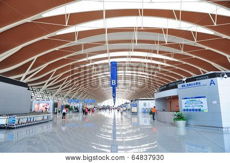 SHANGHAI, CHINA - MAY 27: Pudong Airport interior on May 27, 2012 in Shanghai, China. Pudong airport is the busiest international hub of mainland China, third busiest by cargo traffic in the world.