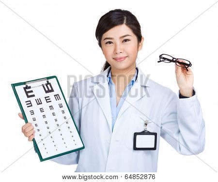 Female doctor holding eyechart and glasses