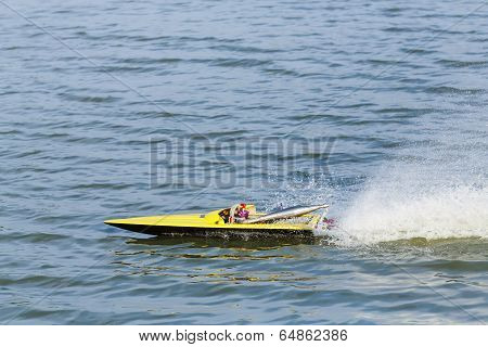 Close up radio controlled fuel engine toy boat in lake poster
