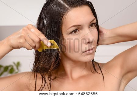 Woman Combing Out Lice In Her Hair