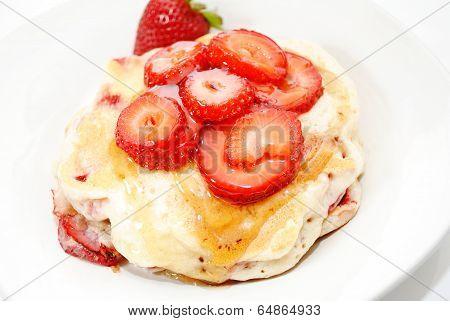 Fresh Sliced Berries On Top Of Hotcakes