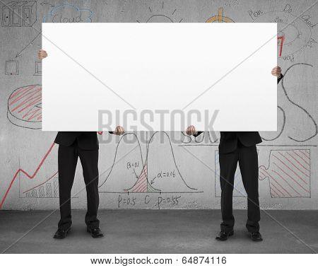 Two Man Holding Board With Business Doodles On Wall