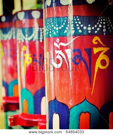 Vintage retro effect filtered hipster style travel image of Buddhist prayer wheels. Tsuglagkhang complex in McLeod Ganj, Himachal Pradesh, India