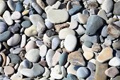 Background of rock pebble stones  found on the beach or a river bed poster