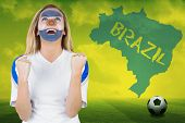 Excited argentina fan in face paint cheering against football pitch with brazil outline and text poster