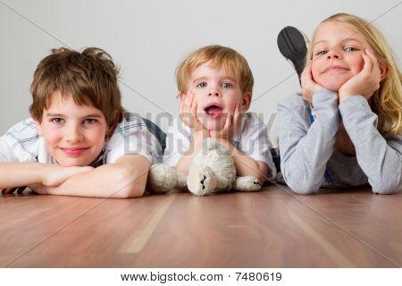 Three Kids On The Floor
