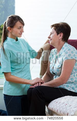 Young Nurse Caring About Her Patient
