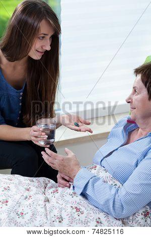 Granddaughter Giving Grandpa Medicines