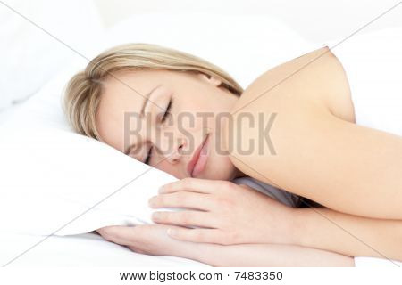 Delighted Woman Sleeping On Her Bed