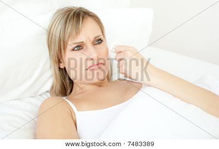Portrait Of A Sick Woman Lying On A Bed