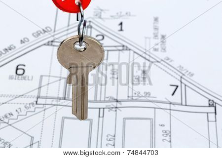 an architect's blueprint with the key of a home or a new home