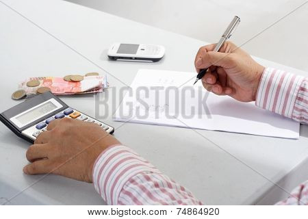 Man working with calculator