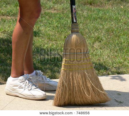 Woman's feet and broom