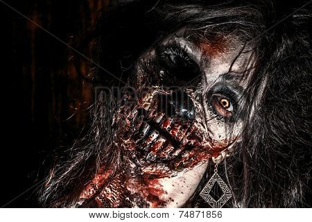 Close-up portrait of a scary bloody zombie girl. Horror. Halloween.  poster