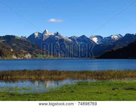 Snow Capped Mountains And Lake Sihlsee