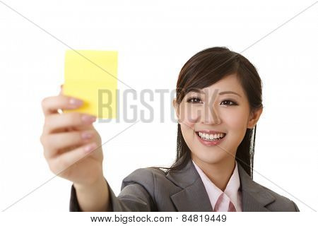Business woman holding one yellow memo stick, closeup portrait on white.