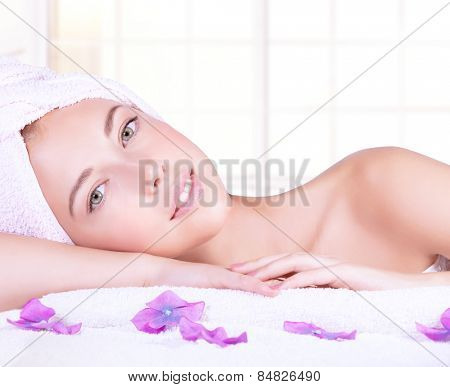 poster of Closeup portrait of beautiful woman with lying down on massage table, enjoying dayspa, natural beauty treatment, luxury spa salon, healthy lifestyle